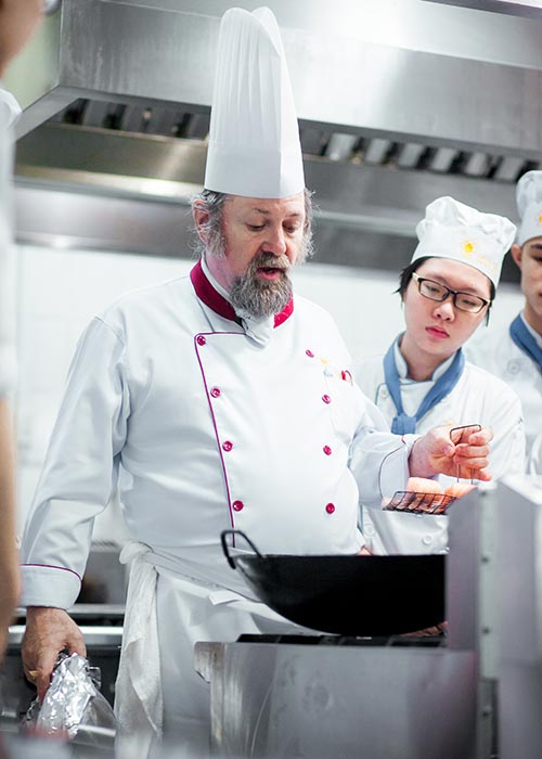 Students practice cooking with European teachers