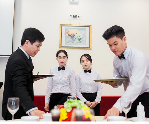 Restaurant management students learn the Practice of restaurant service
